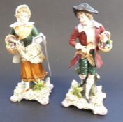 A pair of late 19th century continental hand-decorated porcelain figures; male and female with game,