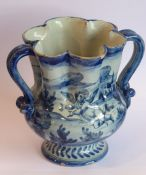 A 19th century Cantagalli two-handled tin glazed earthenware vase decorated with a single cherub