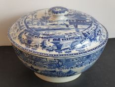 An early 19th century blue-and-white transfer decorated pearlware punch bowl and circular cover; the