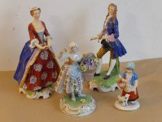 A pair of late 19th/early 20th century hand-decorated porcelain figures in 18th century dress; the