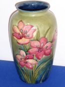 A large Moorcroft pottery vase decorated with red lilies; painted and impressed marks to