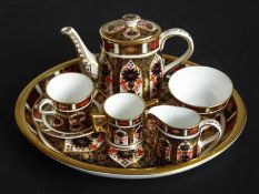 A miniature Royal Crown Derby coffee service comprising coffee pot (7.5cm high inc. cover), tea