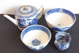 An early 19th century porcelain group; to include a teapot and cover, two bowls each decorated