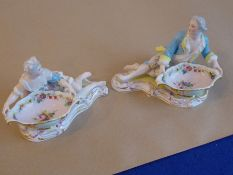 A pair of 19th century hand-decorated continental porcelain bon-bon dishes modelled as recumbent