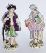 A pair of late 19th/early 20th century hand-decorated Capodimonte porcelain figures; male and
