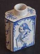 A late 18th century tin-glazed earthenware tea caddy of primarily oval form; the two larger sides