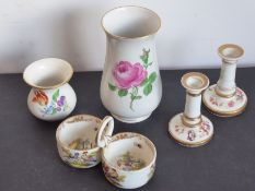A porcelain group of four; a Meissen porcelain baluster-shaped vase decorated with a pink rose, a