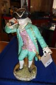 A 19th century Meissen figure model; in 18th century-style dress with a long green coat and