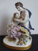 A 19th century hand-decorated Naples porcelain figure model of a scantily clad maiden embracing a