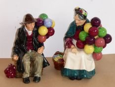 Two Royal Doulton figures 'The Old Balloon Seller' (HN 1315) and 'The Balloon Man' (HN 1954);