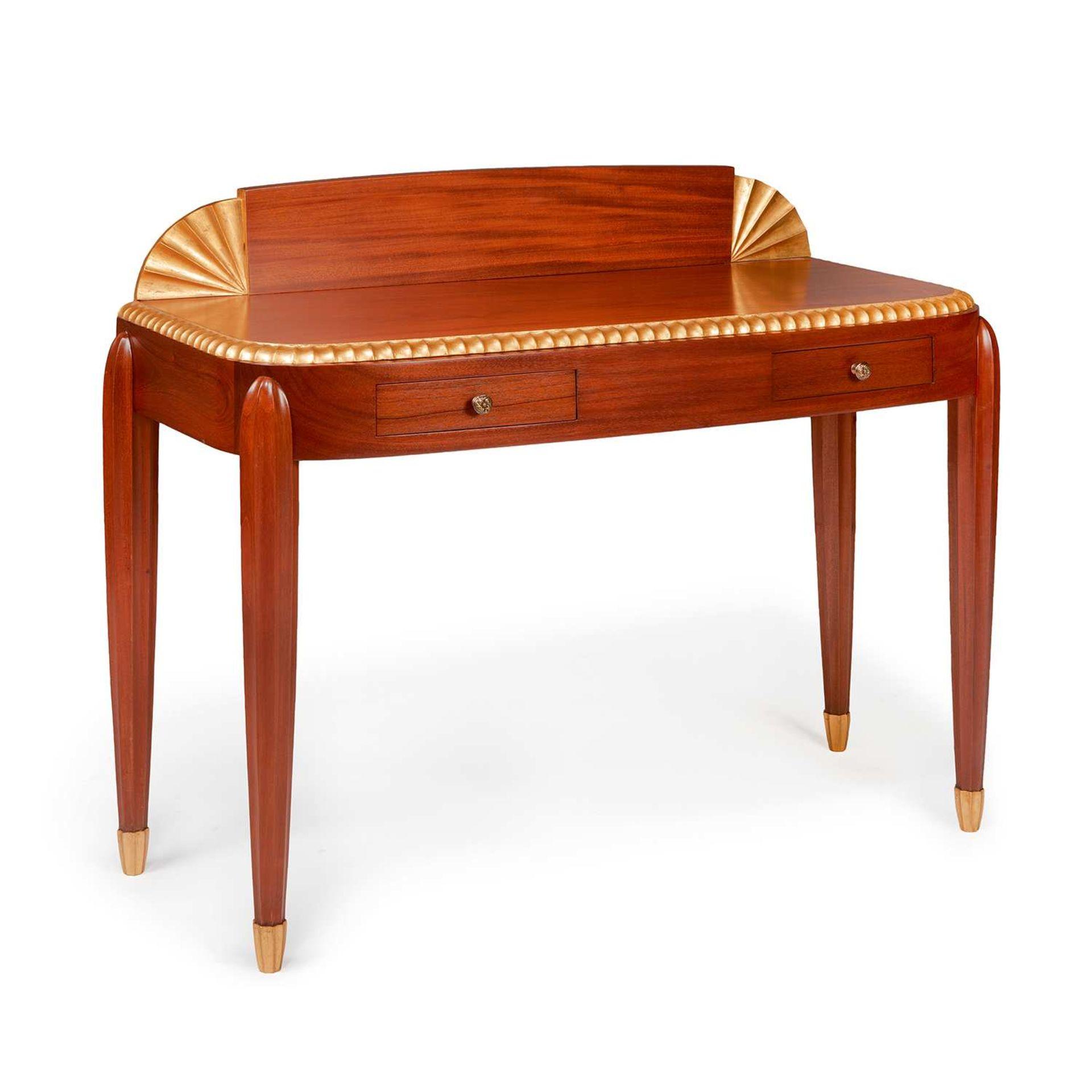 """Los 11 - JULES LELEU (1883-1961) Table à écrire """"Papyrus"""", circa 1925, à structure en acajou sculpté de"""