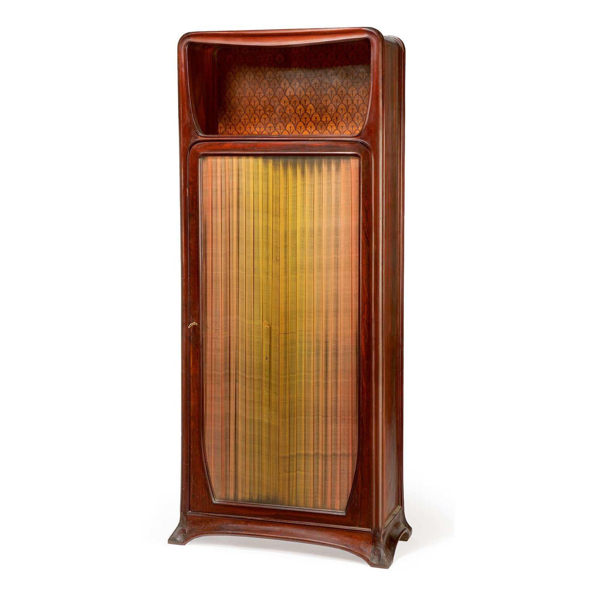 Los 5 - LOUIS MAJORELLE (1859-1926) Meuble de rangement, à structure en acajou et palissandre, piétement