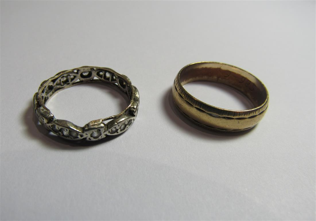 Lot 9 - A marked 375 gold wide band ring with patterned border. Ring size Q, weight 3.5g. Together with a