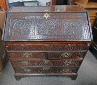 LATE 18TH / EARLY 19TH CENTURY CARVED OAK BUREAU WITH FALL FRONT OVER 2 SHORT & 2 LONG DRAWERS 101