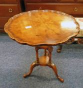 LATE 20TH CENTURY WALNUT CIRCULAR TABLE ON SHAPED SUPPORTS