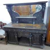 19TH CENTURY CARVED OAK MIRROR BACK SIDEBOARD WITH 4 DRAWERS & 2 PANEL DOORS & FIGURAL DECORATION