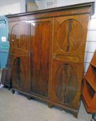 EARLY 20TH CENTURY MAHOGANY TRIPLE DOOR WARDROBE ON BRACKET SUPPORTS Condition Report: