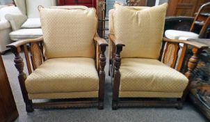 PAIR OF EARLY 20TH CENTURY OAK ARMCHAIRS WITH BERGERE PANELS & TURNED SUPPORTS 81CM TALL