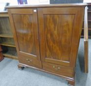 19TH CENTURY MAHOGANY LINEN PRESS WITH 2 PANEL DOORS OPENING TO SHELVES OVER 2 DRAWERS ON BRACKET
