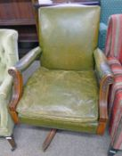 ARTS AND CRAFTS STYLE LEATHER SWIVEL ARMCHAIR Condition Report: Leather has wear,