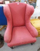 LATE 19TH CENTURY PINK WINGBACK ARMCHAIR ON TURNED SUPPORTS Condition Report: Needs