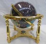 HARDSTONE GLOBE WITH BRASS MOUNT.