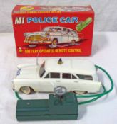 LOUIS MARX M1 BATTERY OPERATED POLICE CAR WITH REMOTE CONTROL.
