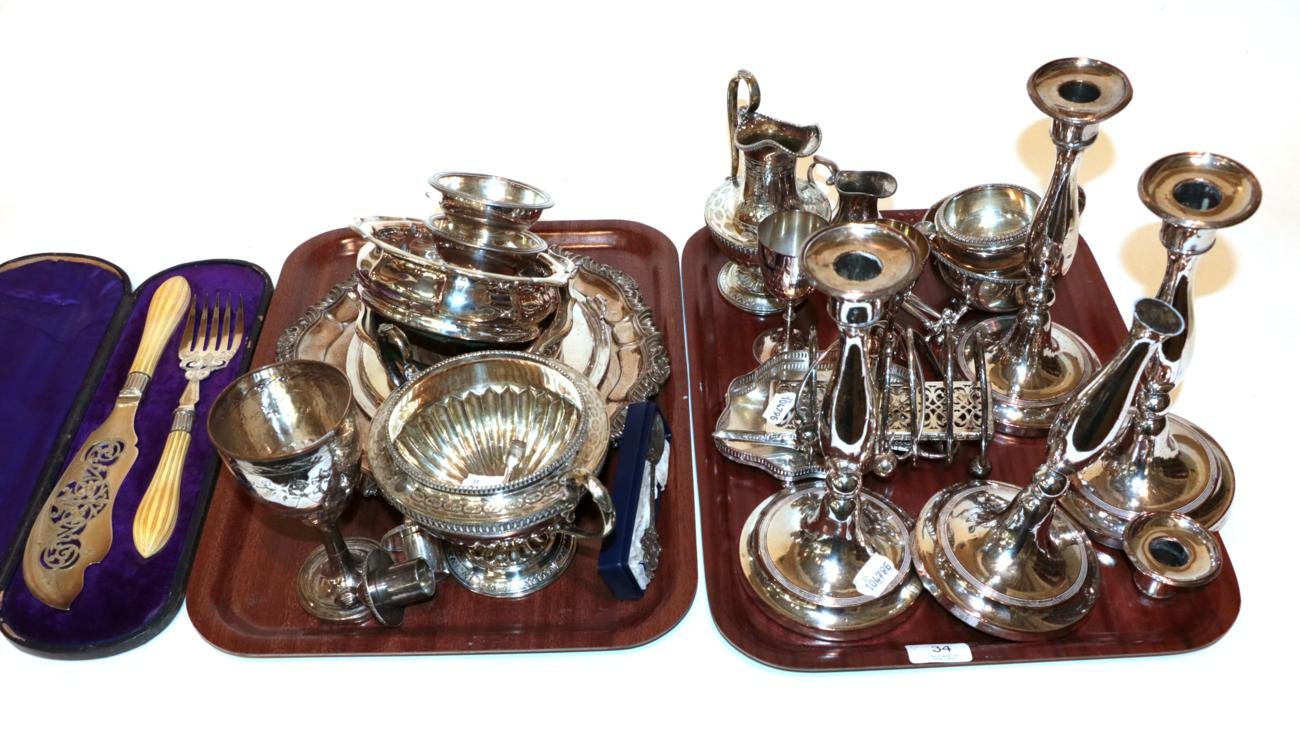 Lot 34 - A collection of assorted silver-plate, including: a set of four candlesticks, one damaged; various