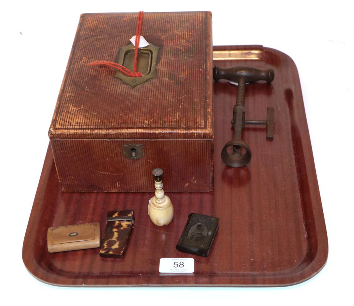 Lot 58 - A leather correspondence box; a 19th century corkscrew; a bone desk seal; a tortoiseshell manicure