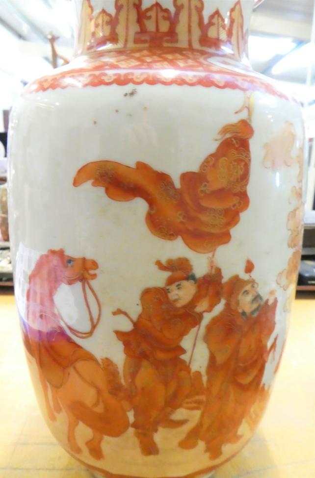 Lot 60 - A late 19th century Chinese vase of baluster form, decorated in ironstone red and gilt, depicting