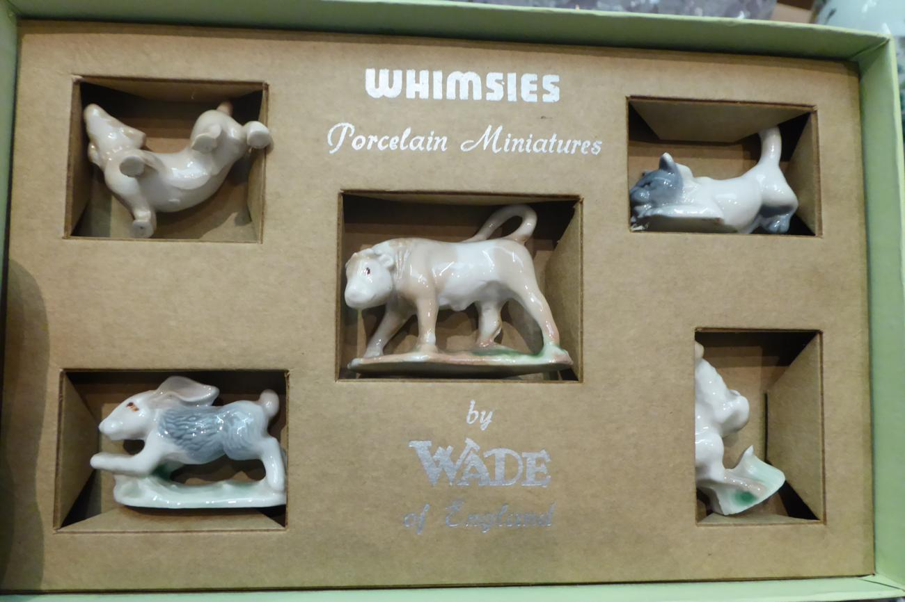 Lot 37 - A collection of Wade Whimsies boxed sets comprising two number one's, two to six inclusive and eight
