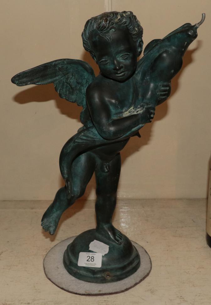 Lot 28 - A bronze figure of a putto