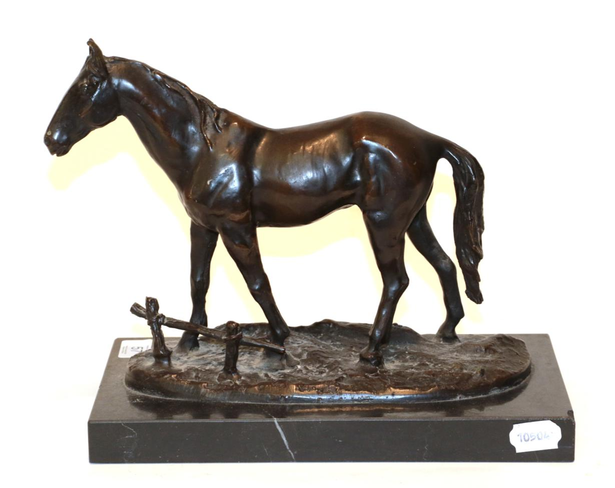 Lot 57 - A bronze model of a horse on a black marble plinth