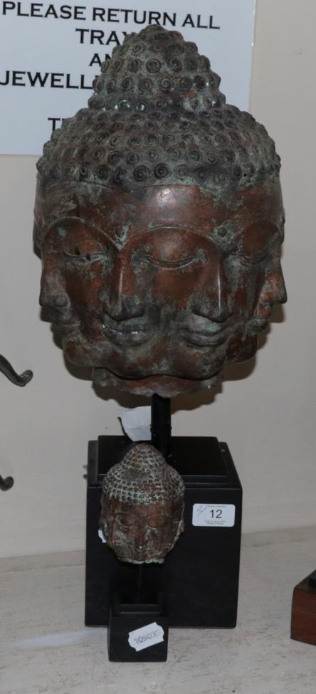 Lot 12 - A bronze multiple face Buddha head and a similar smaller head (2)