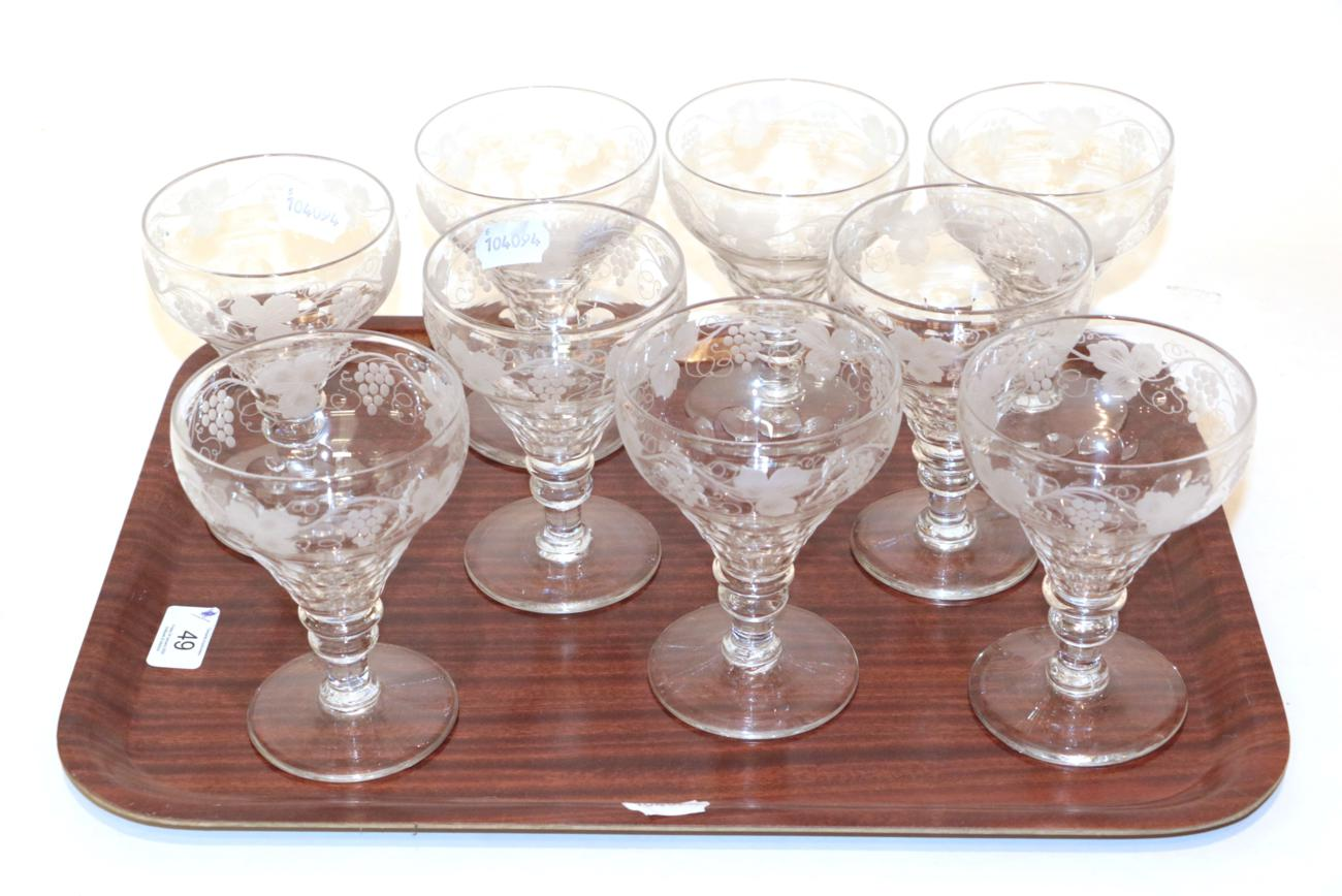 Lot 49 - A set of nine 19th century stemmed wine glasses, etched grape and vine design (9)