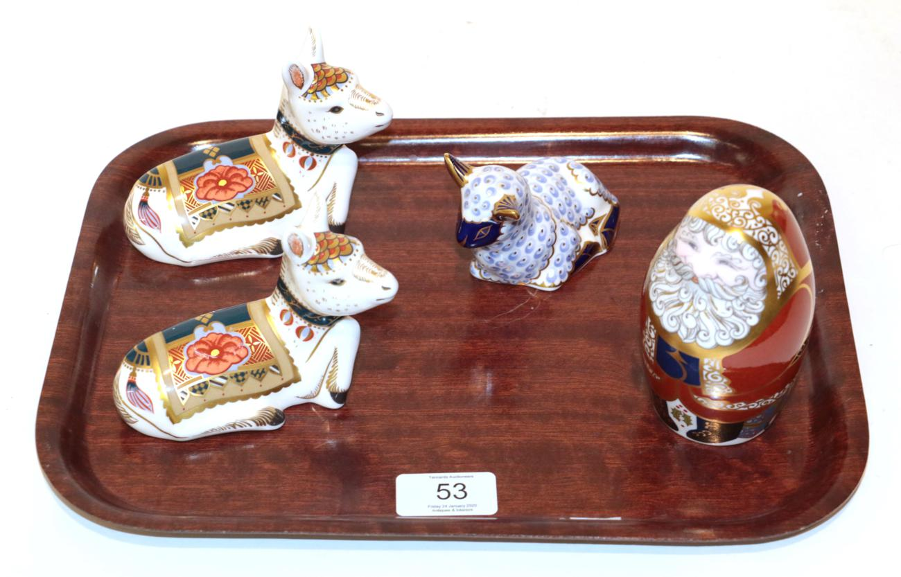 Lot 53 - A Royal Crown Derby Imari palette Father Christmas paperweight; with two Donkey Foals; and a Lamb (