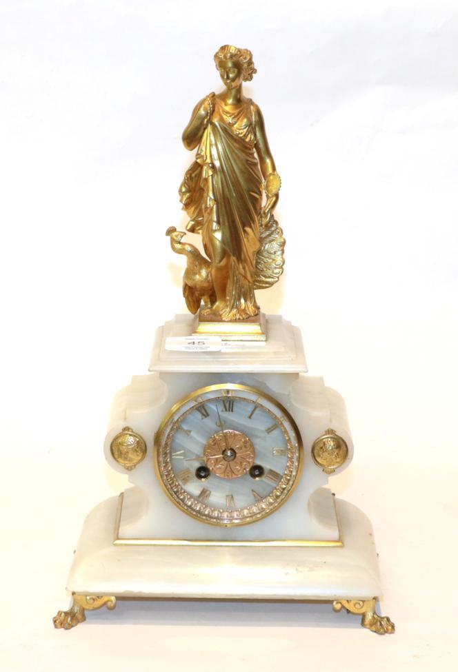 Lot 45 - An onyx striking figural mantel clock