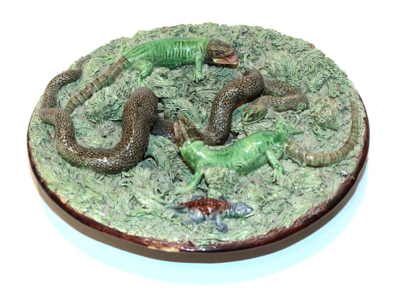 Lot 39 - A Pallisy ware dish depicting snakes and lizards