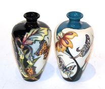 Two Moorcroft butterfly vases (2). 16cm high and in good condition.
