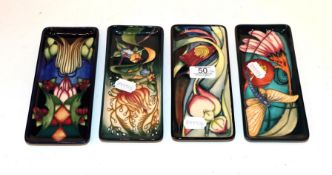 Four various Moorcroft pen trays . 20cm by 9cm. Good condition. All first quality.