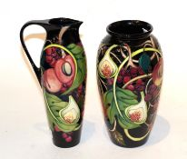 A Moorcroft pomegranate pattern vase and ewer (2) (a.f.) . Ewer - Cracks to the handle and signs