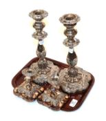 Two pairs of plated candlesticks (4)