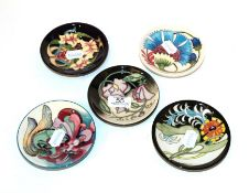 Five Moorcroft miniature dishes, various (5). All are first quality. 12cm diameter (x3), 11.8cm