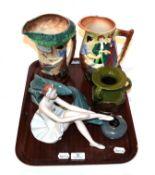 A tray of ceramics including Burleigh ware jugs, Bretby vase, Royal Dux ballerina, Beneagles curling