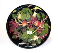 A Moorcroft pomegranate pattern charger