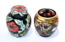 A Moorcroft poppy ginger jar and another (2) . Both first quality. Red flower jar and cover - some