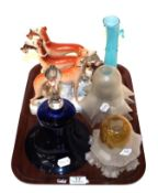 A wall mirror with glass sconce together with a blue glass bell, three Staffordshire hounds and