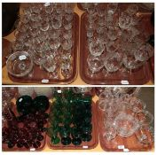 Coloured Victorian glasses and a quantity of engraved glass (on five trays)