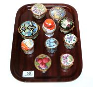 A collection of Moorcroft enamel boxes (10). All first quality. One of the box lids with one minor