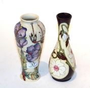 A Moorcroft 'Yorkshire' pattern vase with another (2). Both first quality. Purple flower vase - with